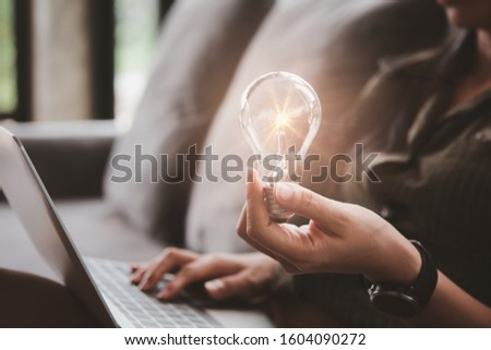 women holding light bulbs, ideas of new ideas with innovative technology and creativity. #1604090272