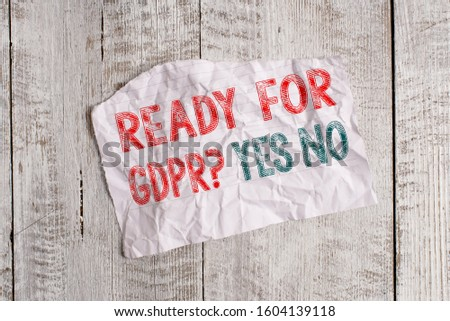 Text sign showing Ready For Gdpr question Yes No. Conceptual photo Readiness General Data Protection Regulation Crumpled torn paper half broken placed above classic wooden background. #1604139118