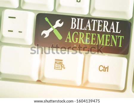 Conceptual hand writing showing Bilateral Agreement. Business photo text Legal obligations to nonbinding agreements of principle. #1604139475