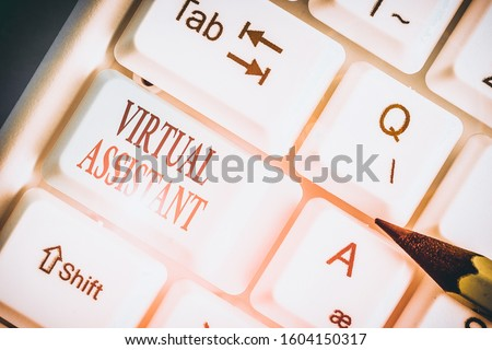 Writing note showing Virtual Assistant. Business photo showcasing demonstrating who provides various services to entrepreneurs. Royalty-Free Stock Photo #1604150317