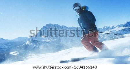 Skier downhill in the mountains #1604166148