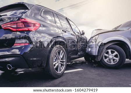 Car crash dangerous accident on the road. Royalty-Free Stock Photo #1604279419