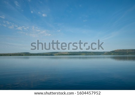 idyllic peaceful calm nature scenic landscape of main land horizon background coast line and ocean bay peaceful water surface foreground in summer time morning, copy space  #1604457952