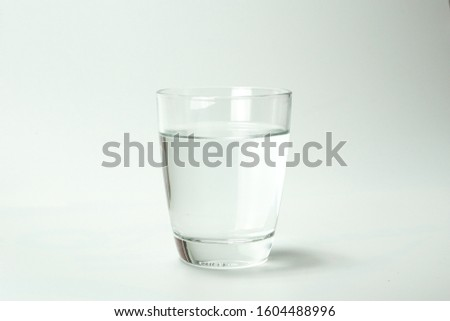 Water in a clear glass on a white background. #1604488996