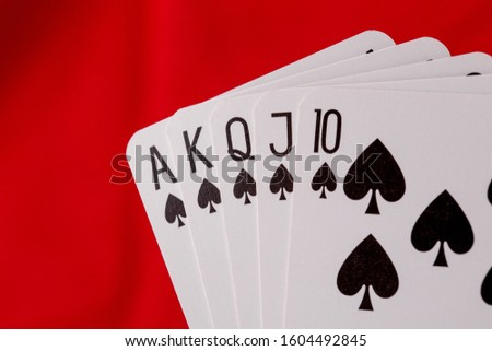 Royal flush playing cards. Red background. #1604492845