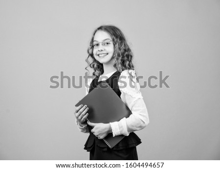 Final exam coming. Girl hold textbook folder test. Preparing to exams in library. Small child formal wear. Formal education and homeschooling. Check knowledge. School exam concept. Prepare for exam. #1604494657