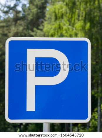 car road sign indicating the place to Park the car, white letter P on a blue background, traffic control on the roads #1604545720