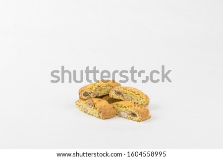 Cantucci (double baked Italian biscuits, biscuits) with orange zest, almond nuts and dried cranberry. Flat layout, front view, place for text. White background. #1604558995