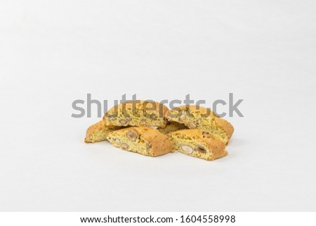 Cantucci (double baked Italian biscuits, biscuits) with orange zest, almond nuts and dried cranberry. Flat layout, front view, place for text. White background. #1604558998