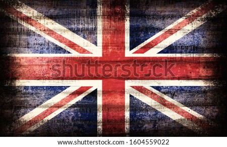 British Union Jack flag painted on old plank dark wall Royalty-Free Stock Photo #1604559022