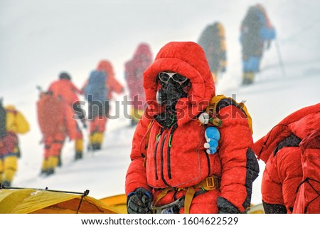 High altitude climber with oxygen mask in the Himalaya mountains #1604622529