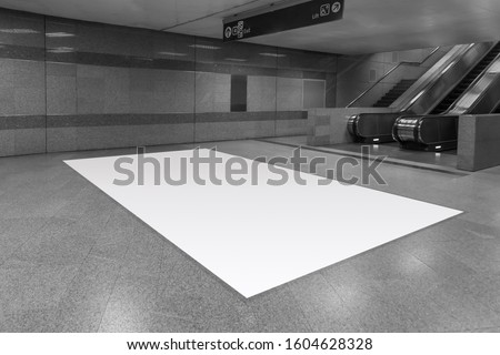 mock up full blank advertising billboard on floor at underground trai,  background large LCD advertisement