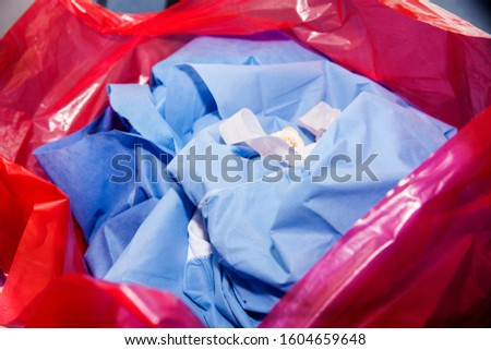 Biological risk waste disposed of in the red trash bag at a operating room in a hospital #1604659648