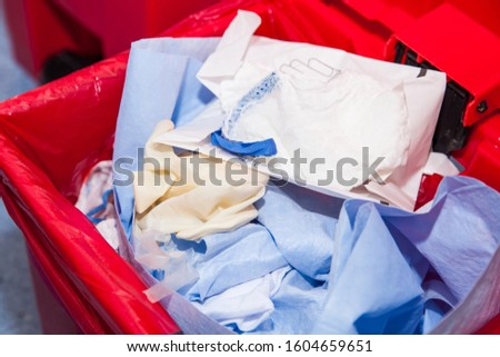 Biological risk waste disposed of in the red trash bag at a operating room in a hospital #1604659651