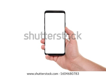 Man hand holding the black smartphone blank screen with modern frameless design isolated on white background #1604680783