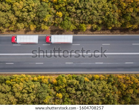 Aerial top down 4k shot of truck on the highway.