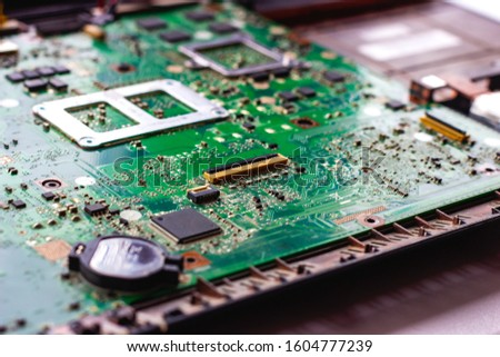 Fixing electronic components inside the pc. Computer hardware, service, upgrade and technology repairing concept #1604777239