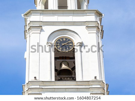 Russian orthodox church. Fragment of bell tower of the Iversky monastery with bell and chime clock in Samara, Russia #1604807254