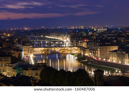 Night aerial view of Florence and Ponte Vecchio over Arno River in Florence, Italy #160487006