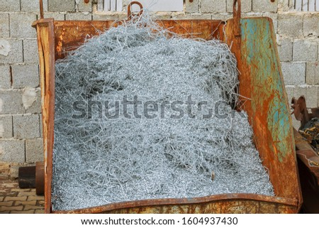 Aluminum shavings. Aluminum processing on CNC machines in production. #1604937430