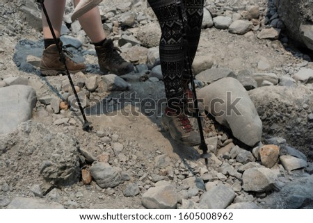Two girl walking with hiking shoes and hiking poles #1605008962
