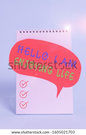 Word writing text Hello I Am Enjoying Life. Business concept for Happy relaxed lifestyle Enjoy simple things Standing blank spiral notepad speech bubble lying cool pastel background. #1605021703