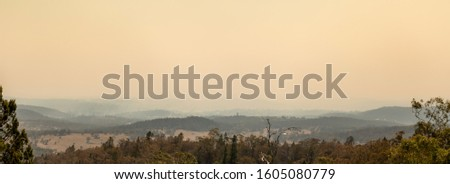 Cooma, Australia 2019-12-30 Australian bushfire: Panoramic view of Cooma,NSW covered with smoke haze from bushfires. Unhealthy air conditions. #1605080779