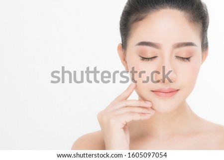 Beautiful Young Woman with clean fresh skin, Proposing a product. Gestures for advertisement on white background #1605097054