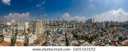 Sunny afternoon aerial panorama of Binh Thanh District of Ho Chi Minh City featuring key buildings and a low level of air pollution #1605163192