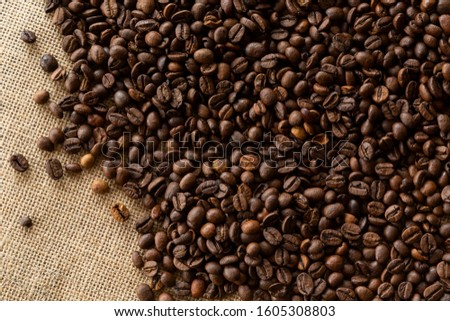 Structured linen background with roasted coffee beans #1605308803