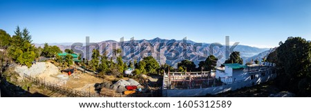 Panoramic mountain range view from Mussoorie city situated in Uttarakhand, India. Natural landscape of barren mountains in Dehradun. Travel photography in Uttarakhand. Blue mountains in India. - Image #1605312589