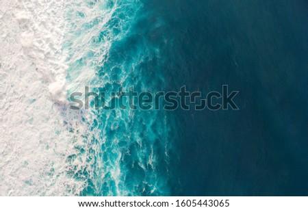 Aerial view to waves in ocean Splashing Waves. Blue clean wavy sea water. Royalty-Free Stock Photo #1605443065