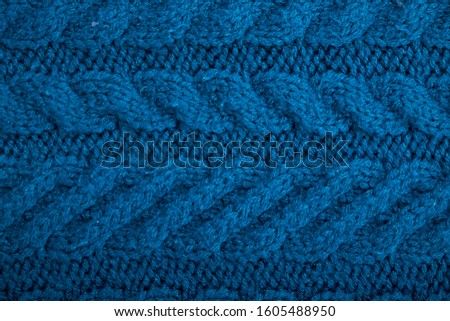 Knitted background. Knitted texture. A sample of knitting from wool. Knitting Pattern. #1605488950