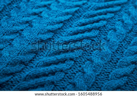 Knitted background. Knitted texture. A sample of knitting from wool. Knitting Pattern. #1605488956