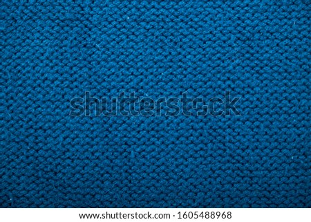 Knitted background. Knitted texture. A sample of knitting from wool. Knitting Pattern. #1605488968