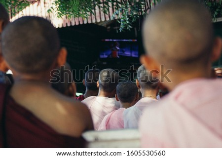 nurse and monks watching television #1605530560