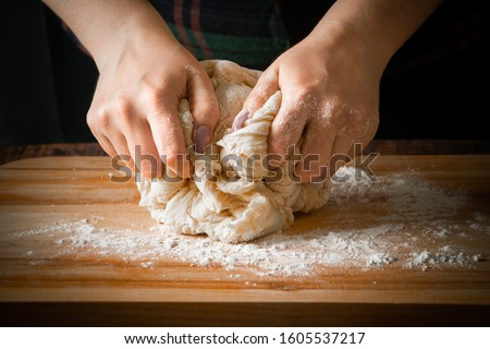 Woman cook kneads pizza dough, cooking meal close up #1605537217
