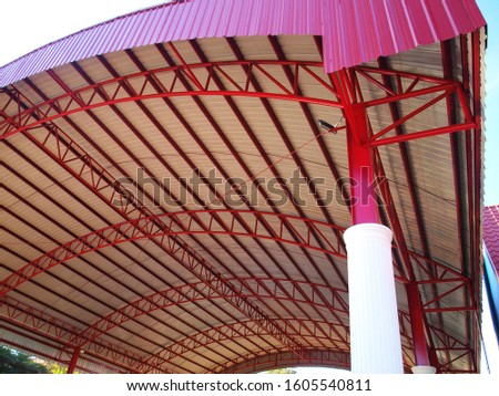 Metal columns and red roof structure The roof of the dome thatched with metal sheets #1605540811