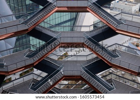 New York, NY - January 1 2020: View of the stairways inside the Thomas Heatherwick designed Vessel sculpture at Hudson Yards #1605573454