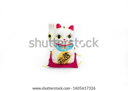 Ceramic lucky cat with red carpet isolated #1605617326