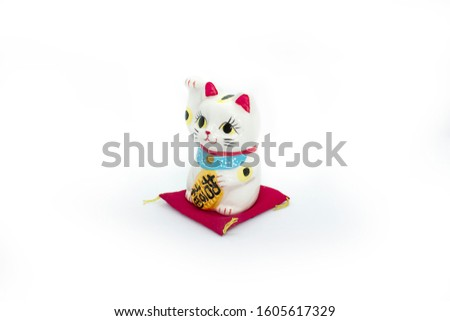 Ceramic lucky cat with red carpet isolated #1605617329