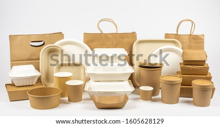 Group shot of biodegradable and recyclable food packaging on white background, paper plates, cups, containers, bags, no logos Royalty-Free Stock Photo #1605628129