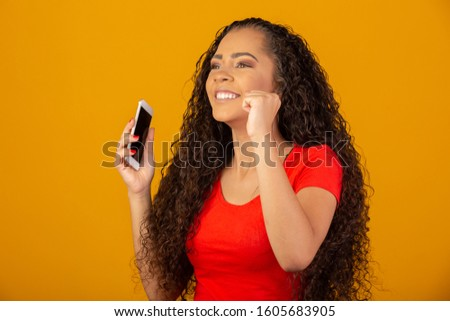Beautiful African American young woman happy and excited celebrating victory expressing big success, power, energy and positive emotions. Celebrates new job joyful. #1605683905