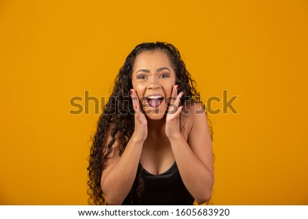 Beautiful African American young woman happy and excited celebrating victory expressing big success, power, energy and positive emotions. Celebrates new job joyful. #1605683920