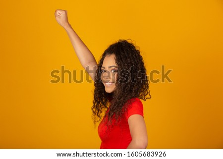 Beautiful African American young woman happy and excited celebrating victory expressing big success, power, energy and positive emotions. Celebrates new job joyful. #1605683926