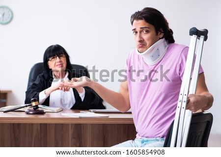 Disabled man consulting judge for damages litigation #1605854908