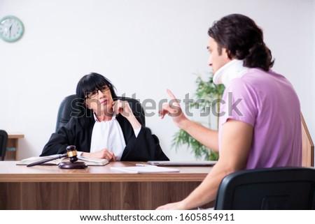 Disabled man consulting judge for damages litigation #1605854911