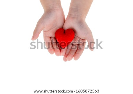 Love and Medical Cocept: two hans of a good health kid holding red heart with white backgorund and clipping path #1605872563