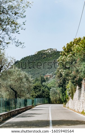 Scenic road in near the mountains. Picturesque view from the car window. #1605940564