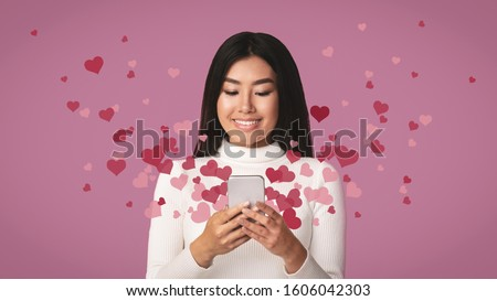 Love mail. Girl holding phone with hearts flying out from smartphone #1606042303